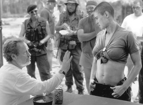 Director Ridley Scott talking to Demi Moore on the set of G.I. Jane.